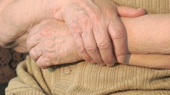 Elderly woman hand with wrinkled skin Stock Footage
