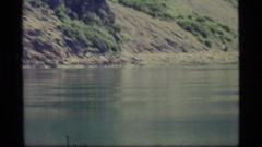 1977: shaking video of a body of water with raised land on the side GLACIER BAY Stock Footage
