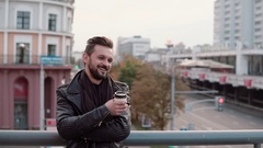 A stylish handsome man with a beard and trendy haircut smiling cheerfully Stock Footage