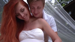 Happy couple hugging pregnant belly. Couple hands in heart on pregnant belly Stock Footage