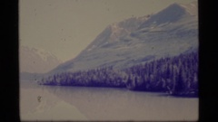 1977: a large area full of water covered with mountains on its sides ALASKA Stock Footage