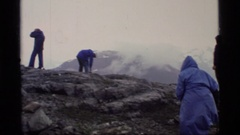 1977: people outdoors on a misty day gathered on a rock knob with views GLACIER Stock Footage