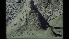 1977: a hiker walking with his backpack across a desolate spot GLACIER BAY Stock Footage