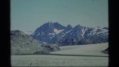 1977: a large area with lots of grass and a mountain around GLACIER BAY ALASKA Stock Footage