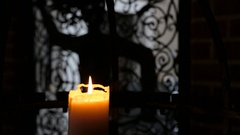 Burning candle in interere ancient castle Stock Footage