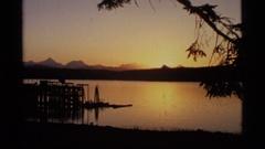 1977: orange sunset fade into the end closing credits. GLACIER BAY ALASKA Stock Footage