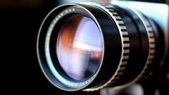 Camera Lens Zoom And Aperture Rings Rotating and Panning Stock Footage