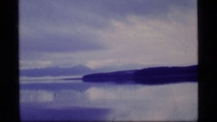 1977: gentle ripples flow over the surface of a large lake GLACIER BAY ALASKA Stock Footage