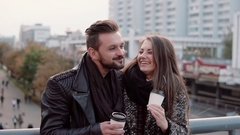 Two happy young people have fun. Handsome young man and beautiful girl laugh Stock Footage