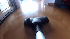 Vacuum Cleaner POV Hoovering Wooden Floor and Carpet Stock Footage