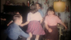 Children dancing to the latest tunes at birthday party, 3828 vintage home movie Stock Footage
