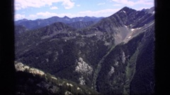 1977: lots of trees grow all over the sides of a large mountain SAPPHIRE LAKE Stock Footage