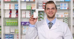 Pharmacist Man Show a White Box Medicine Hand Gestures Ok Sign Pharmacy Concept Stock Footage