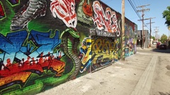 Aerial drone footage of Los Angeles graffiti alley behind Melrose Avenue Stock Footage