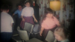 Children play musical chairs at birthday party, 3829 vintage film home movie Stock Footage