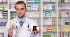 Pharmacist Man Showing Expensive Medicine Pills Money Euro Bills Pharmacy Store Stock Footage