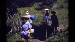 1977: best friends trekking on forest SAPPHIRE LAKE MONTANA Stock Footage