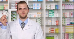 Pharmacist Man Showing Talk Promoting Medicine Drug Pills Pharmacy Store Concept Stock Footage