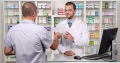 Pharmacist Man Negative Answer Patient Pharmacy Medicine Not Found Pharmacy Shop Stock Footage