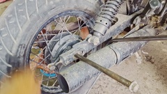 Closeup Man Hands Assemble Wheel to Motorcycle in Repair-shop Stock Footage
