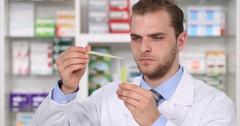 Chemist Man Analyzing New Remedy Drugs Pharmacy Laboratory Medicine Development Stock Footage