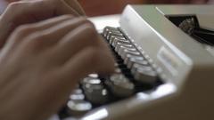 Man writing on a vintage typewriter keys Stock Footage