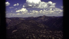 1977: the camera zoom in close on one mountain in a range of mountains SAPPHIRE Stock Footage