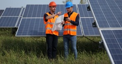Engineer Men Teamwork Hold Plan and Digital Tablet Handshaking Solar Panels Area Stock Footage