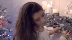 Beautiful sexy brunette woman flirting on background of Christmas decorations Stock Footage