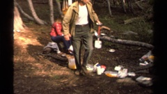 1978: a group of people whose setting up a camp in the middle of the forest. Stock Footage