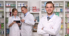 Pharmacist Man Smiling Pharmacy Staff Teamwork Collaboration Personnel Working Stock Footage