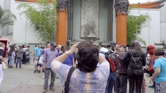 Woman tourist taking picture of Chinese Theater in Hollywood Los Angeles Stock Footage