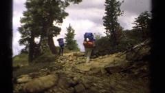 1978: three backpackers walking side slope across scree LAKE TAHOE CALIFORNIA Stock Footage