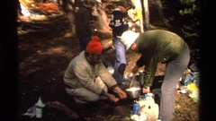 1978: stirring food in a pot on a campfire LAKE TAHOE CALIFORNIA Stock Footage