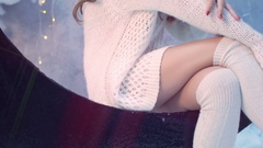 Closeup of gentle sensual brunette girl wearing a white knited sweater over Stock Footage