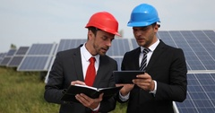 Inspector Business Engineer Men Use Digital Tablet Talking Solar Panels Energy Stock Footage