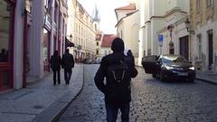 PRAGUE, CZECH REPUBLIC - DECEMBER 3, 2016. Asian tourist carrying backpack Stock Footage