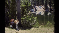 1978: hikers making their way through a dense forest LAKE TAHOE CALIFORNIA Stock Footage