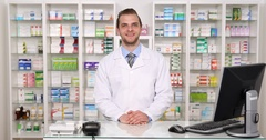 Experienced Pharmacist Man Looking Camera Positive Yes Answer in Pharmacy Store Stock Footage