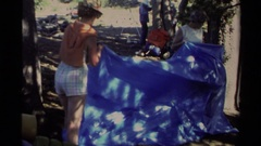 1978: three ladies work together to pitch a tarp tent LAKE TAHOE CALIFORNIA Stock Footage