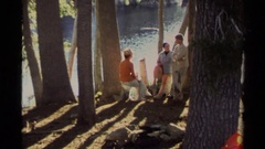 1978: group of people sitting together near a body of water LAKE TAHOE Stock Footage