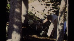 1978: a man getting some stuff on the ground and trying to knot a bait  Stock Footage