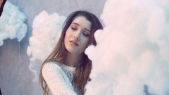 Closeup of gentle sensual brunette girl wearing a white knited sweater with Stock Footage