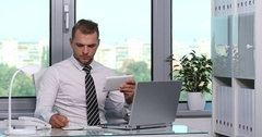 Busy Office Activity Ceo Business Man Talk on Phone Multitasking Digital Tablet Stock Footage