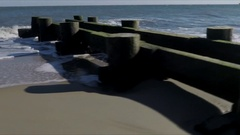 Rehoboth Beach: Panning shot over old wooden dock structure Stock Footage