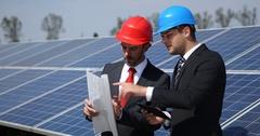 Business Men Team Work Collaboration Planning Examine Digital Plans Solar Panels Arkistovideo