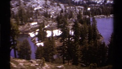 1978: serene bodies of water in the forest with snow and ice on the ground.  Stock Footage