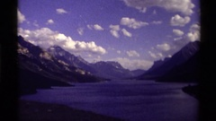 1979: beautiful valley with a lake and steep ridges on either side and peaks in Stock Footage