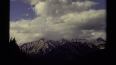 1979: majestic gray mountains sit high in the sky near the clouds CANADA Stock Footage