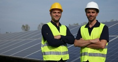 Happy Engineer Men Presentation Look Camera Optimistic About Photovoltaic Cells Stock Footage